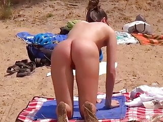 Teen on the beach with wonderful ass close-up
